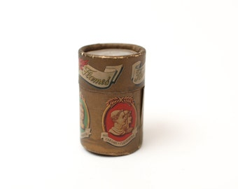 vintage match box. famous flames cylindrical match box with matches.