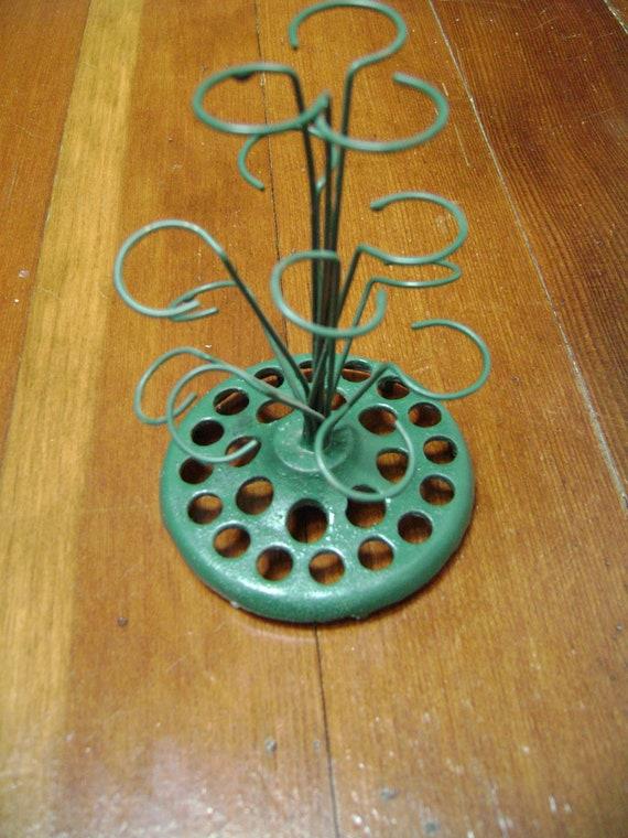 vintage green curly flower frog