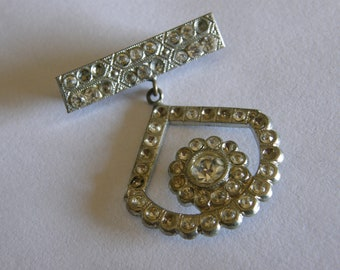 Vintage Art Deco rhinestone dangle brooch from the 1920's or 30's