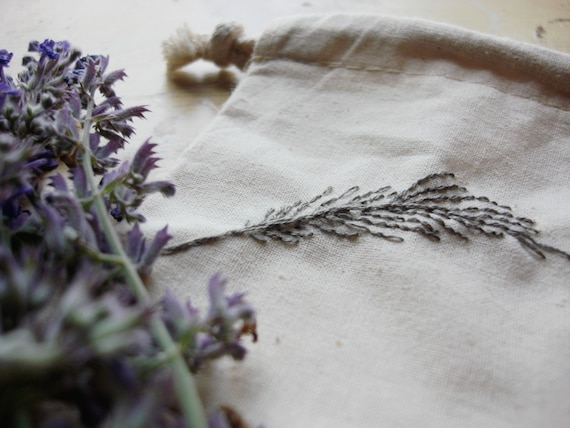 SALE- hand embroidered feather pouch