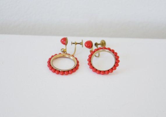 Vintage red circle earrings.