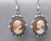 Cameo earrings in antique silver setting