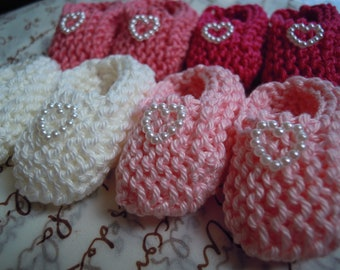 Girl baby shower decorations: 4 pairs of little hand knitted booties with pearlised hearts - pink/ white  2 inches - DECORATION SIZE