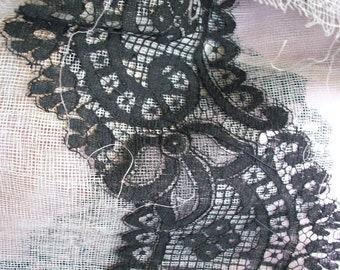 1 yard of Early black lace on original tarlatan backing