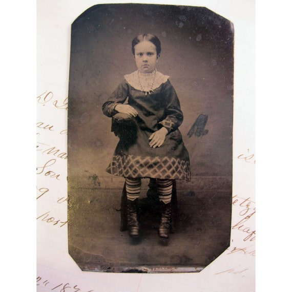 antique tintype photo - girl with STRIPED STOCKINGS - sitter - late 1800s, ferrotype - tt275
