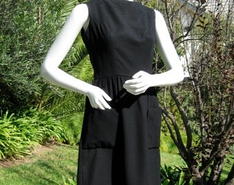 Chic 1960s LBD black wool dress with large patch pockets  S