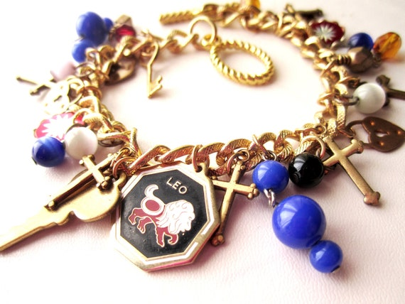 Vintage Regal Assembled LEO Multi Charm Bracelet - gold, brass, red, black, white, blue