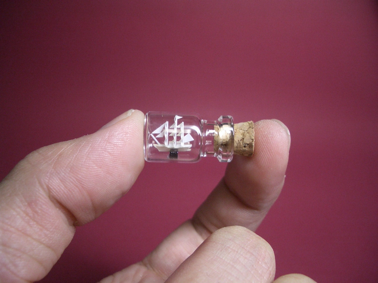 Tiny Sailing Ship is in a tiny bottle Bottle ship
