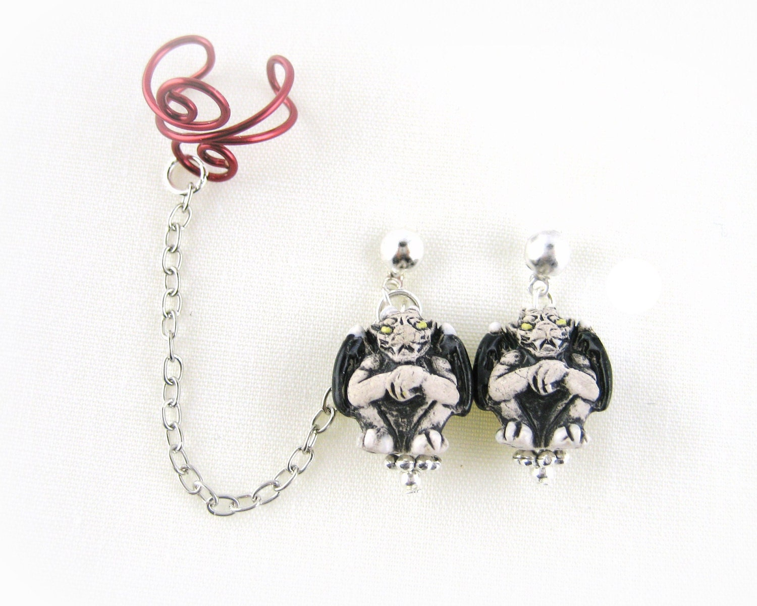Ear Cuff Earrings With Chain http://www.etsy.com/listing/107634633/gothic-earring-earcuff-gothic-ear-cuff