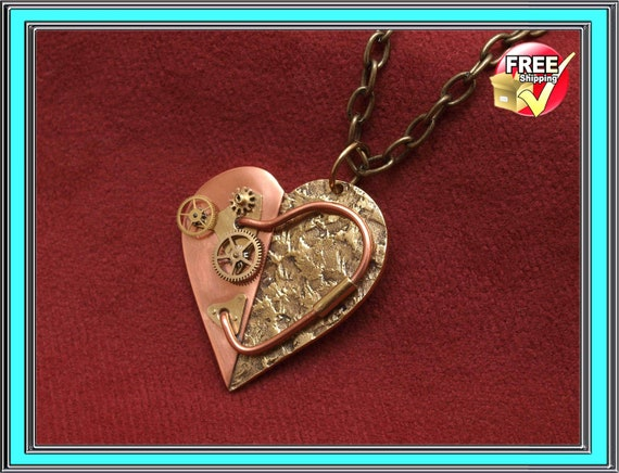 Steampunk jewelry, mechanical heart, pendant necklace.