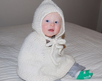 Hand Knit baby poncho with hood made of pure white soft  wool Pick size.Made to order Winter fashion  Christmas gift Handmade in Colorado