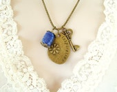 Inspiration Brass Necklace. Charms, Inspiration with flower, Key with heart, Handmade Blue ceramic glazed bead. Brass Chain.