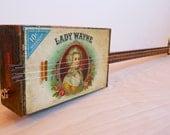 Cigar box slide guitar, electric. Made in Maine