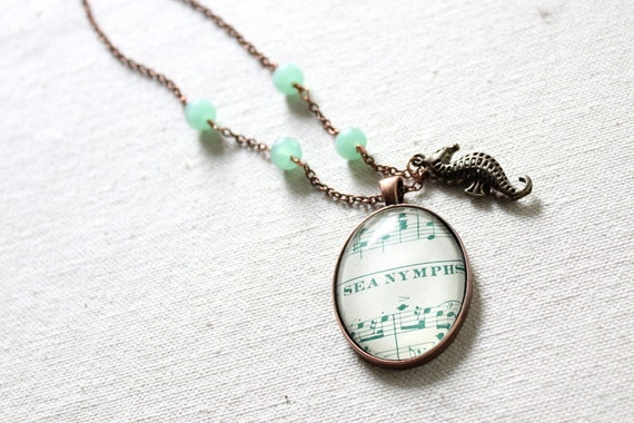 Sea Nymph necklace dreamy beach accessory from vintage sheet music and sea horse charm with sea foam green beads