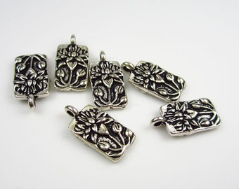 6 Silver Tierracast lotus charms