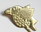 Tiny bird flying brooch
