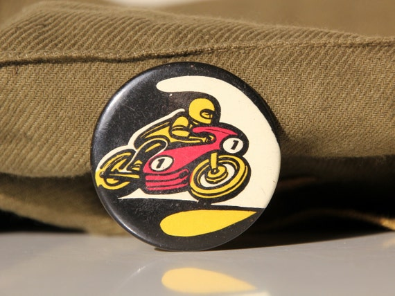 Vintage metal pin from USSR, motorcyclist