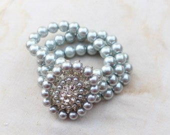 Very cute  buckle  with  rhinestones  and grey  color  pearls  you can wear like a  bracelet  1 pieces listing