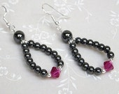 Ruby Red Swarovski crystal bicones and black Hematite stone loop earrings on silver finished surgical steel earwires.
