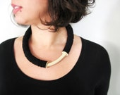 black minimal bold geometric tube necklace with an ivory curve