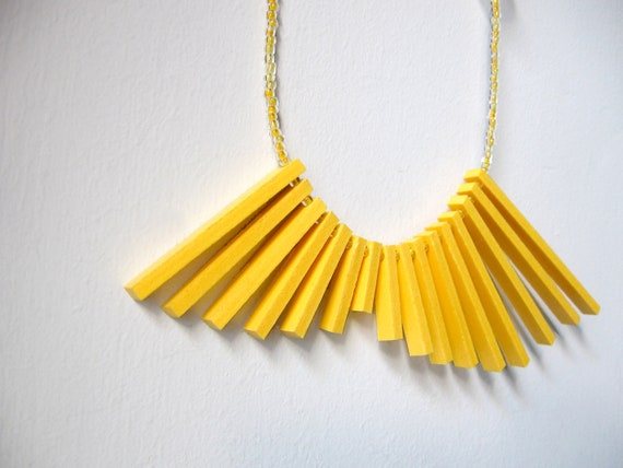 geometric yellow necklace with plastic sticks and glass beads