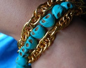 turquoise skulls and gold chain bracelet