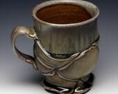 Coffee / Tea Cup, green celadon, shino glaze, wood fired porcelain