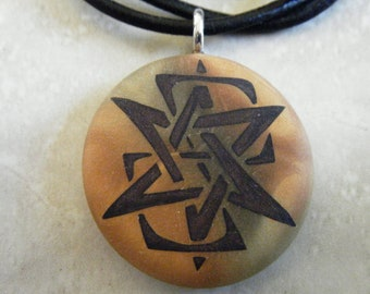 Star of David designer hand carved  on a polymer clay gold and antique gold blend background. Pendant. Comes with a FREE necklace