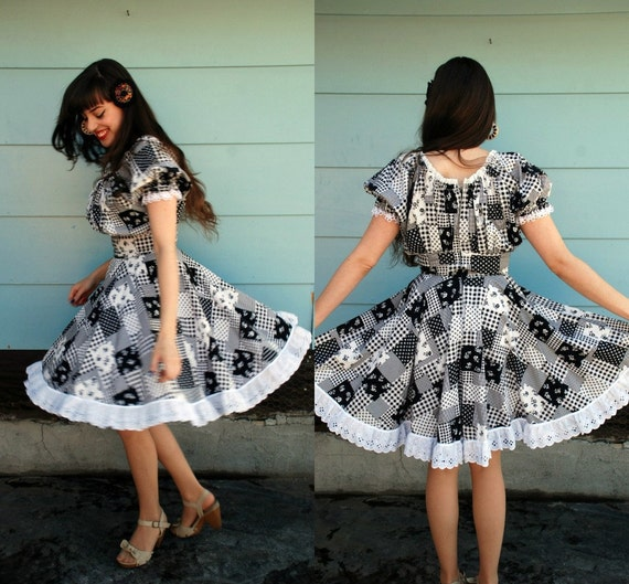 1970s. off the shoulder dress with full skirt. m-l
