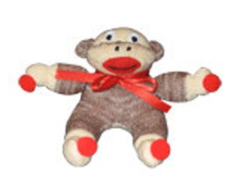 Small baby sock monkey, made from real red heel sock.