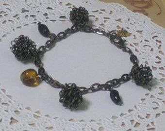 Antique Spiral Charm Bracelet - Antique Spirals, Black and Topaz Charms On Gunmetal Chain - Sale