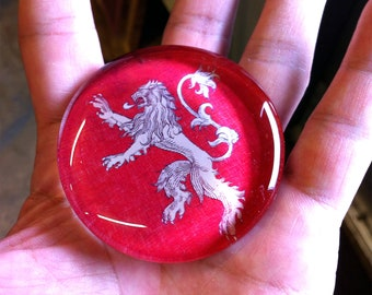 House Lannister style glass paperweight