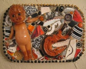 HAPPY HALLOWEEN Plaque in Orange and Black Featuring a Celluloid Doll and Iron Hook Mosaic Art