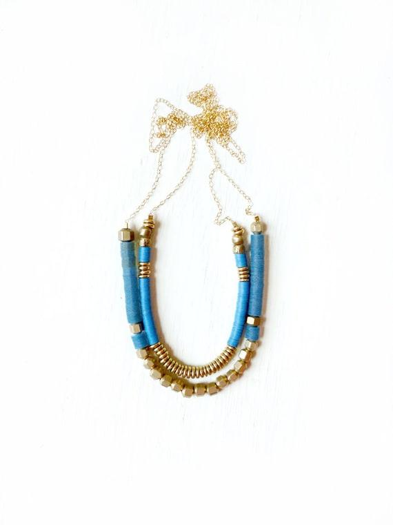 Blue brass necklace