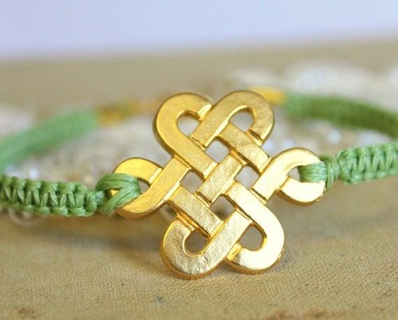 Friendship bracelet celtic knot green braided 14k gold plated .