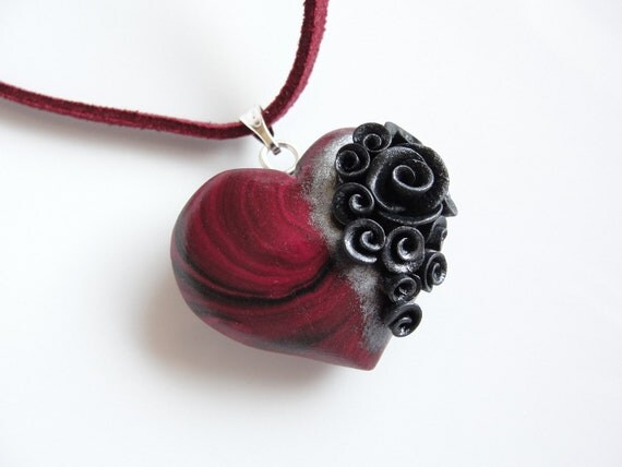 Swirly red and black heart pendant with black and silver roses on faux suede cord necklace