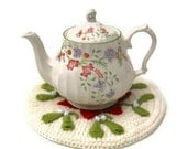 Crochet teapot stand coaster hot pad Christmas mistletoe and poinsettia traditional doily mat in festive red and green