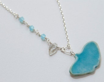 Gingko Leaf Necklace in Turquoise with opaque turquoise crystals.