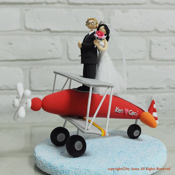 Cute Couple On The Red Plane Custom Wedding Cake Topper