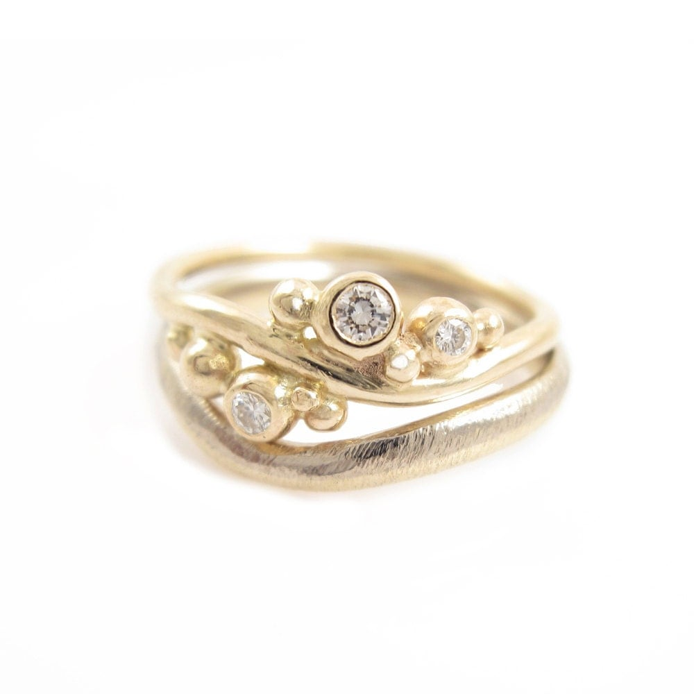 engagement and wedding ring gold white gold and diamonds