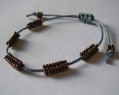 Macrame beaded bead bracelet in bronze and blue gray