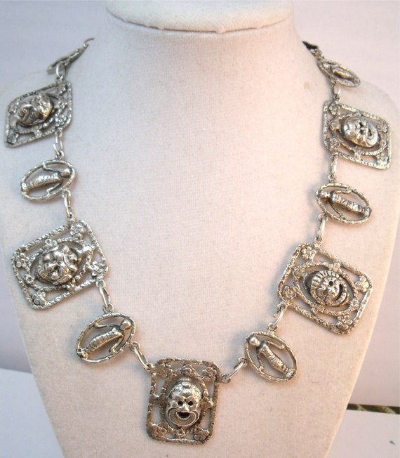 Fantastic silver necklace  with Della Robbia babies and devil faces