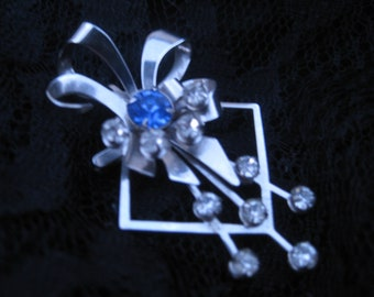 atomic brooch and pendant