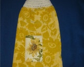 Yellow hanging towel with yellow flower