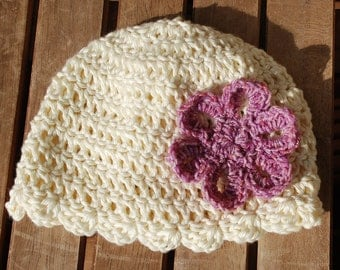 Pink flower on cream color baby hat