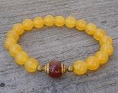 Genuine yellow jade gemstone mala bracelet with Tibetan capped carnelian guru bead