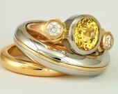 Custom wedding bands and engagment ring sets, platinum and 18 karat  gold, yellow sapphire and diamonds