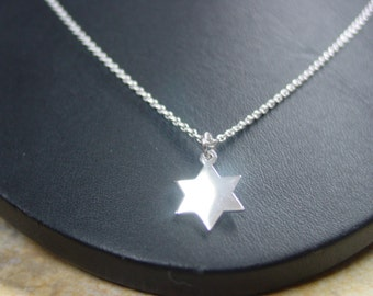 star ,  solid  sterling silver whith  no chain