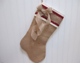 Burlap stocking with bow and red accents