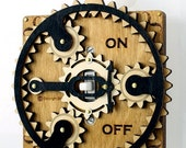 Black and Tan Planetary Gear Light Switch Plate